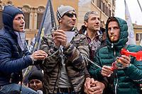 Roma 17 Marzo 2015<br /> Manifestazione dei precari della scuola, 4mila da tutt&rsquo;Italia,davanti a Montecitorio, contro il decreto legge sulla scuola, del governo Renzi, che li esclude dalle assunzioni.Manifestanti si incatenano per protesta.<br /> Rome March 17, 2015<br /> Demostration of temporary school, 4 thousand from all over Italy,in front of Deputies, against the education reform package known as 'Good school' set up by Renzi's government, which excludes them from employment. Protesters chain themselves in protest.