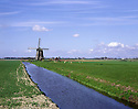 AA00431-02...NETHERLANDS - Windmill on a canal near Amsterdam.