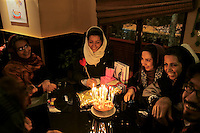 "A birthday party for Vaghar, 27. She is an illustrator and teaches engraving at the Art University of Tehran. She was asked what her dreams are: ""My dream is to be married and for this reason I put a ring on one of the candles on my cake."""