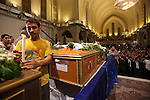 An Egyptian Coptic man lights a candle over the coffins of the victims of sectarian violence during an October 10, 20011 funeral  at the Coptic Cathedral  Cairo, Egypt. At least 26 people, mostly Christian, were killed during sectarian clashes that saw the worst violence since the Revolution that toppled former Egyptian president Hosni Mubarak earlier this year. Egyptian Coptic Christians make up about 10% of Egypt's 80 million population and periodically violence flares between the Christian minority and the majority Muslim population. (Photo by Scott Nelson)