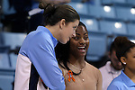 21 November 2013: UNC assistant coach Ivory Latta (right) with Megan Buckland (left) before the game. The University of North Carolina Tar Heels played the Coastal Carolina University Chanticleers in an NCAA Division I women's basketball game at Carmichael Arena in Chapel Hill, North Carolina. UNC won the game 106-52.