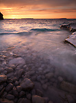 Colorful sunset over Georgian Bay rocky shore. Bruce Peninsula National Park, Ontario, Canada.