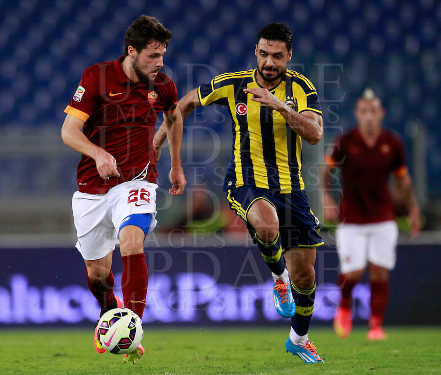 Calcio, amichevole Roma vs Fenerbahce. Roma, stadio Olimpico, 19 agosto 2014.<br /> Roma forward Mattia Destro is challenged by Fenerbache midfielder Bekir Irtegur, right, during the friendly match between AS Roma and Fenerbahce at Rome's Olympic stadium, 19 August 2014.<br /> UPDATE IMAGES PRESS/Isabella Bonotto