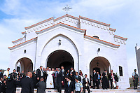 Pope Benedict XVI, background center, waves to faithful during his visit to the Lady of Peace Church in Amman, Jordan Friday, May 8, 2009