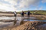 Surfers on the beach at Croyde Bay, North Devon.