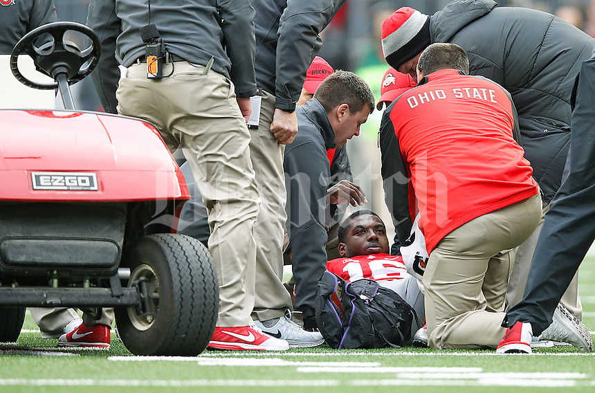 Ohio State Buckeyes quarterback J.T. Barrett (16) lies injured on the field in the second half at Ohio Stadium on November 29, 2014. (Chris Russell/Dispatch Photo)