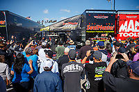 Apr 22, 2017; Baytown, TX, USA; Fans surround the pit area of NHRA top fuel driver Troy Coughlin Jr as he warms up during the Springnationals at Royal Purple Raceway. Mandatory Credit: Mark J. Rebilas-USA TODAY Sports