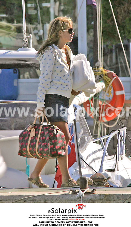 ALL ROUND EXCLUSIVE PICTURES FROM SOLARPIX.COM.***RIGHTS FOR AUSTRALIA ONLY, NO RIGHTS FOR SALE IN NEW ZEALAND***.*MUST CREDIT SOLARPIX.COM OR DOUBLE FEE CHARGED*.Jade Jagger demonstrated how to get changed three times inside ten minutes on a quayside in Ibiza this week..Rolling Stone Mick Jagger's daughter Jade and some friends were due to go out on a boat trip for the day, but before they left, she decided to try on some different outfits which she had stashed in the boot of her car. Using skills acquired from many visits to the local beach, she pulled on a white Ibizan style dress before removing her swimsuit and shorts. She then slipped on a Japanese style embroidered jacket before finally opting for a hooded cardigan with denim skirt for her trip..DATE:06.06.06       JOB REF: 2452 MSR