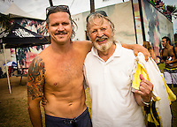 North Shore, Oahu, HAWAII - (Friday, Nov. 15, 2013) -- Brad Gerlach (USA) with his father Joe at the contest. The REEF Hawaiian Pro is the first stop of the $960,000 Vans Triple Crown of Surfing.<br /> The contest has until November 23 to run four full days of competition where 128 of the world's best surfers will compete for critical ASP Prime points and a share of $250,000 prize money. The winner of this event will take home $40,000 and an early lead on the 2013 Vans Triple Crown series ratings. <br /> <br /> A bad day turned good for 6-time Vans Triple Crown champion Sunny Garcia (HAW) today, bowing out of the main event but getting the better of a fun reunion with three other legends of the sport to win the exhibition REEF Clash of the Legends. The $10,000 first prize definitely helped to lift his mood. His former tour traveling partner Kaipo Jaquias (HAW) was second; Michael Ho (HAW) was third; and California's Brad Gerlach (USA) was fourth. This was Garcia's second &quot;Clash&quot; title.Photo: joliphotos.com