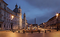 Piazza Navona at dawn showing Fontana del Moro (Fountain of the Moor), 1575, Giacomo della Porto, Egyptian obelisk of the Fontana dei Quattro Fiumi (Fountain of the Four Rivers) in the distance and 17th century Baroque church of Sant'Agnese in Agone on the left, Rome, Italy. Picture by Manuel Cohen