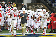 Annapolis, MD - October 8, 2016: Houston Cougars head coach Tom Herman leads his team on the field during game between Houston and Navy at  Navy-Marine Corps Memorial Stadium in Annapolis, MD.   (Photo by Elliott Brown/Media Images International)