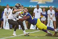 Newark, DE - October 29, 2016: Delaware Fightin Blue Hens linebacker Jasawn Thompson (29) sacks Towson Tigers quarterback Triston Harris (12) during game between Towson and Delware at  Delaware Stadium in Newark, DE.  (Photo by Elliott Brown/Media Images International)