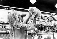 New York, New York USA, June 1979 - French singer Sylvie Vartan with her dog Sniff, in a shop. At the time she was in the US to promote her first American album.