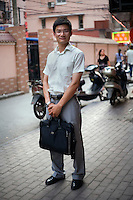 Zhengyaojin, a gas distributor, age 25, poses for a portrait in Nanjing. Response to 'What does China mean to you?': 'To me, the meaning of China is home, and it represents great security and strong national defense.'  Response to 'What is China's role in the future?': 'A long history and splendid society.'