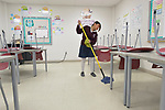 Fernanda Gaspar, 13, mops a classroom in the Lydia Paterson Institute in El Paso, Texas, where most of the students cross the border every day from their homes in Juarez, Mexico, to study at the United Methodist-sponsored high school. Many repay part of their scholarship by spending two hours a day cleaning the school.