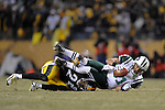 PITTSBURGH, PA - JANUARY 23: Dustin Keller #81 of the New York Jets is tackled by Ryan Clark #25 of the Pittsburgh Steelers in the AFC Championship Playoff Game at Heinz Field on January 23, 2011 in Pittsburgh, Pennsylvania(Photo by: Rob Tringali) *** Local Caption *** Dustin Keller