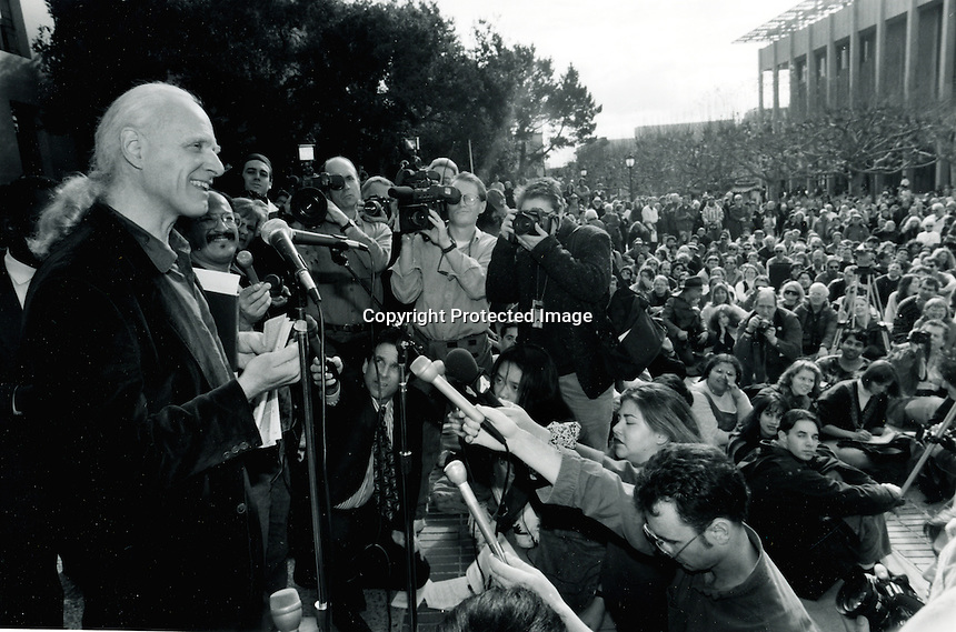 "White haired Mario Savio speaking to the crowd gathered at Sproul Plaza on the University of California at Berkeley campus for the anniversity of the ""free speech"" movement,  that began at U.C. 30 years before in the mid 60's, and led by Savio (photo Dec 2,1994 by Ron Riesterer)"