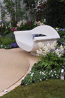 Evening Garden, circular deck, white chair bench, illumination by spotlights, garden lights, perennials, flowers, pretty spot to relax