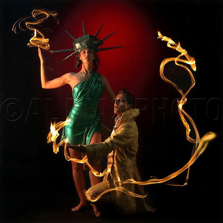 Performing artist Amber Joy Rava poses as the Statue of Liberty as Shuki Shaulian represents the French who presented the vision of Liberty to a young America.