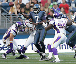 Seattle Seahawks'  quarterback Tavaris Jackson passes in the first quarter of a pre season game while being pass rushed by Minnesota Vikings'  defensive end's Jared Allen (69), Tremaine Johnson and defensive tackle Letroy Guion on Saturday August, 2011 at CenturyLink Field in Seattle.  The Vikings beat the Seahawks  20-7. ©2011 Jim Bryant Photo. All Rights Reserved.