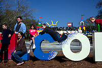 Guests to Legoland, Florida, pose on the welcome sign in front of Legoland in Whitehaven, Florida on February 11, 2012.