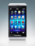 Blackberry Z10 smartphone. White phone isolated on blue white gradient background with clipping path