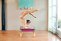 Creative acrobat balancing in a beautiful elbow stand.