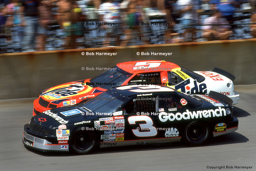 BROOKLYN, MI - JUNE 23: Dale Earnhardt (#3) drives ahead of Ricky Rudd during the Miller Genuine Draft 400 onJune 23, 1991, at the Michigan International Speedway near Brooklyn, Michigan.