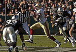San Francisco 49ers wide receiver Terrell Owens (81) makes run after catch on Sunday, November 3, 2002, in Oakland, California. The 49ers defeated the Raiders 23-20 in an overtime game.