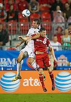 26 June 2010:  Los Angeles Galaxy forward Alan Gordon #21 and Toronto FC defender Dan Gargan #8 in action during a game between the Los Angeles Galaxy and the Toronto FC at BMO Field in Toronto..Final score was 0-0...
