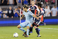 Graham Zusi Sporting KC holds off Lee Nguyen (24) New England... Sporting Kansas City defeated New England Revolution 3-0 at LIVESTRONG Sporting Park, Kansas City, Kansas.