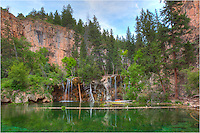 Hanging Lake is about 7 miles east of Glenwood Springs on I-70. To reach the emerald waters of this Colorado icon, you have to hike about 1.2 miles and gain over 1000 vertical feet. The hike is pretty easy, and the rewards is an amazing view of one of Colorado's most beautiful and famous waterfalls and lakes. <br /> <br /> Hanging Lake is a popular day hike for Colorado folks and tourists, so get there early. I've visited the area twice and made the hike up in the dark, arriving just before the first light of day. Each time I had to  place to myself to consider the wonders of this amazing location.