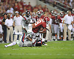 Alabama wide receiver Amari Cooper (9) vs. Ole Miss defensive back Charles Sawyer (3) at Bryant-Denny Stadium in Tuscaloosa, Ala. on Saturday, September 29, 2012.