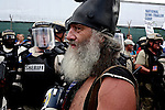 Vermin Supreme talks to riot police during a protest during the 2012 Republican National Convention in Tampa, Fla. on Aug. 28, 2012. Photo by Greg Kahn