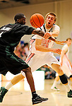 13 February 2011: University of Vermont Catamount forward Matt Glass, a Redshirt Junior from Underhill Center, VT, in action against the Binghamton University Bearcats at Patrick Gymnasium in Burlington, Vermont. The Catamounts came from behind to defeat the Bearcats 60-51 in their America East matchup. The Cats took part in the National Pink Zone Breast Cancer Awareness Program by wearing special white jerseys with pink trim. The jerseys were auctioned off following the game with proceeds going to the Vermont Cancer Center. Mandatory Credit: Ed Wolfstein Photo