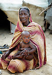 A woman and child in Timbuktu, a city in northern Mali which was seized by Islamist fighters in 2012 and then liberated by French and Malian soldiers in early 2013.  They belong to the Bella ethnic group, which has traditionally been exploited by Timbuktu's lighter-skinned groups.