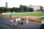 People walking in front of Schlossplatz, Berlin, Germany. Tilted lens used for shallow depth of field.