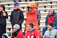 College Park, MD - NOV 26, 2016: A cold young Maryland Terrapins fan is wrapped inside a sleeping blanket during the game between Maryland and Rutgers at Capital One Field at Maryland Stadium in College Park, MD. Maryland defeated Rutgers 31-13. (Photo by Phil Peters/Media Images International)