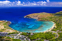Aerial view of Hanauma Bay; one of Oahu's most popular attractions with it beautiful palm tree lined beach and warm blue waters full of colorful fish.. A snorkelers paradise.Located on the southeastern coast of Oahu.