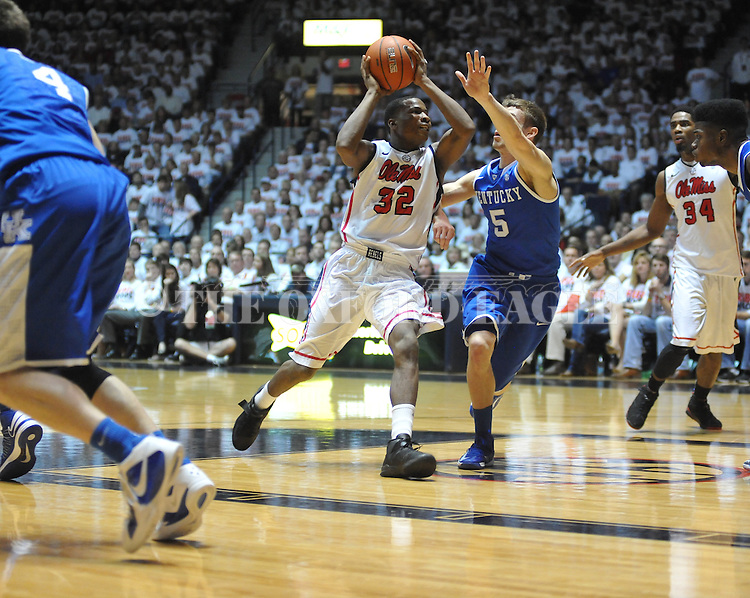 "Ole Miss' Jarvis Summers (32) vs. Kentucky's Jarrod Polson (5) at the C.M. ""Tad"" Smith Coliseum on Tuesday, January 29, 2013."