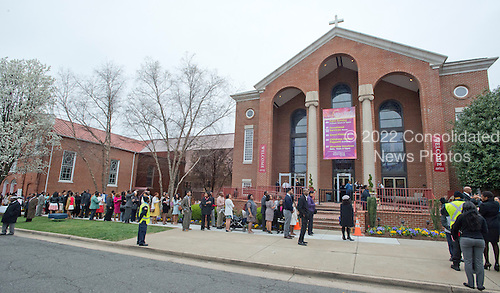 Parishioners wait in line outside the historic Alfred Street Baptist Church in Alexandria, Virginia where United States President Barack Obama and the First Family are to celebrate Easter on Sunday, March 27, 2016.<br /> Credit: Ron Sachs / Pool via CNP