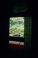 A window looks out on a garden scene from a meditation temple in Kyoto.
