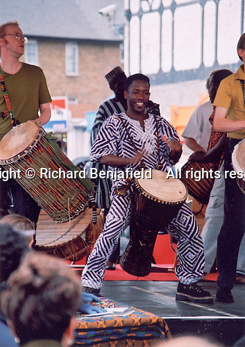 Percussionists playing traditional Ghananian music on djembes and dun duns on the Master Musicians of Ghana Tour, London 2000.