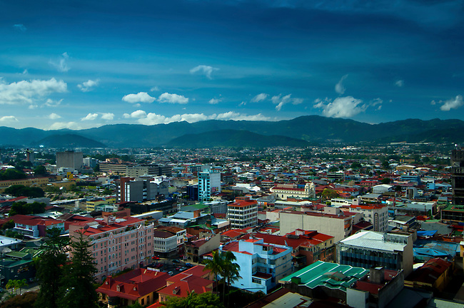 Downtown San Jose, the capital city of Costa Rica.  The volcanic mountain range, the Cordillera Central, surrounds the valley.