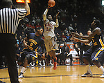 "Ole Miss guard Chris Warren (12) shoots as Murray State guard Isacc Miles defends at the C.M. ""Tad"" Smith Coliseum in Oxford, Miss. on Wednesday, November 17, 2010."