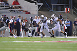 Ole Miss' Jeff Scott (3) runs against Southern Illinois' Boo Rodgers (29) and Southern Illinois' Joe Okon (41) at Vaught-Hemingway Stadium in Oxford, Miss. on Saturday, September 10, 2011.