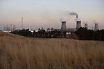 SECUNDA, SOUTH AFRICA JULY 7: A Sasol coal-to-liquid fuel plant stands at dusk on July 7, 2008 in Secunda, South Africa. The plant is the largest synthetic fuels facility in the world and it produces about 35 % of South Africa?s liquid fuel needs including petrol. The plant is the world?s single largest emitter of carbon dioxide on the planet. (Photo by Per-Anders Pettersson/Getty Images)....