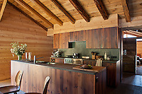 The kitchen/dining area has been created in the former hayloft with walls lined with new pine