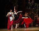 London, UK. 30.03.2013. The Mikhailovsky Ballet present DON QUIXOTE at the London Coliseum. Picture shows: Olga Semyonova (Mercedes) and Evgeny Deryabin (Espada). © Jane Hobson.