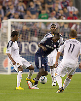 Alex Cazumba taps the leg of a dribbling New England Revolution midfielder Shalrie Joseph (21). The New England Revolution defeated LA Galaxy, 2-0, at Gillette Stadium on July 10, 2010.